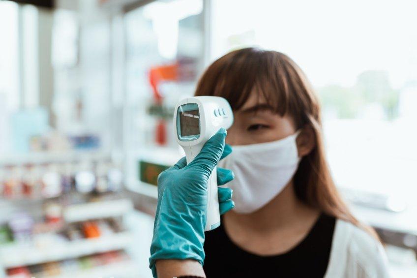 person getting temperature taken